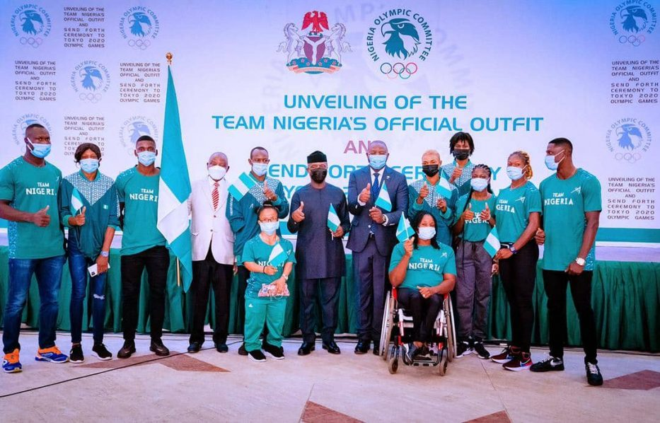 Buhari unveils Team Nigeria's official outfit, wants repeat of 1996, 2000 feat